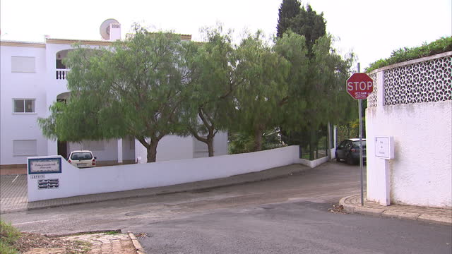 exterior shots of a stop sign with 'stop mccann circus' graffiti'd onto it and views over the resort of praia da luz on 26 october 2016 in praia da... - madeleine mccann stock videos & royalty-free footage