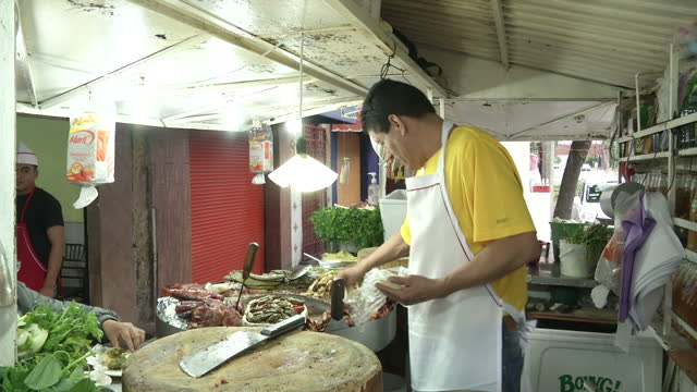 exterior shots of a street food vendor at a roadside stall cooking and selling tacos in mexico city on july 09 2015 in mexico city mexico - taco stock videos & royalty-free footage