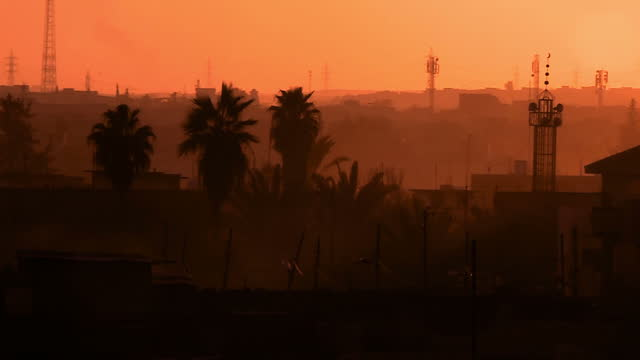 exterior shots of a sunset over mosul with radio towers on an army base on 24 march 2017 in mosul iraq - mosul stock videos and b-roll footage