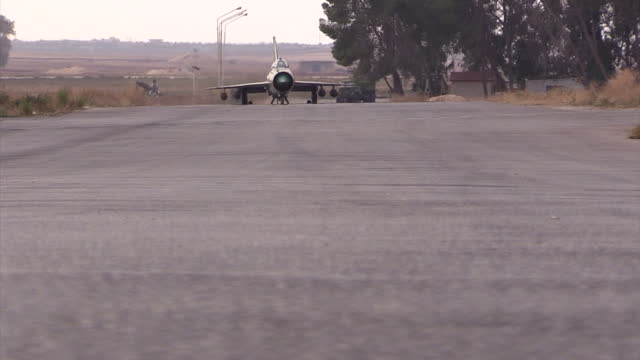 Exterior shots of a Syrian air force Mig21 fighter jet taxxing to its hanger on December 21 2015 in Latakia Syria