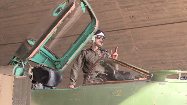 Exterior shots of a Syrian air force Mig23 fighter bomber with very rusty bombs under its wings being readied for flight on December 21 2015 in...