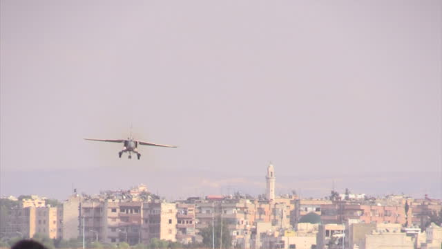 Exterior shots of a Syrian Air Force Mig23 Flogger fighter bomber jet circling above Latakia airbase then landing on December 21 2015 in Latakia Syria