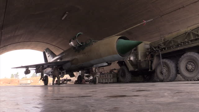 Exterior shots of a Syrian air force pilot getting into the cockpit of an elderly Mig21 fighter jet on December 21 2015 in Latakia Syria