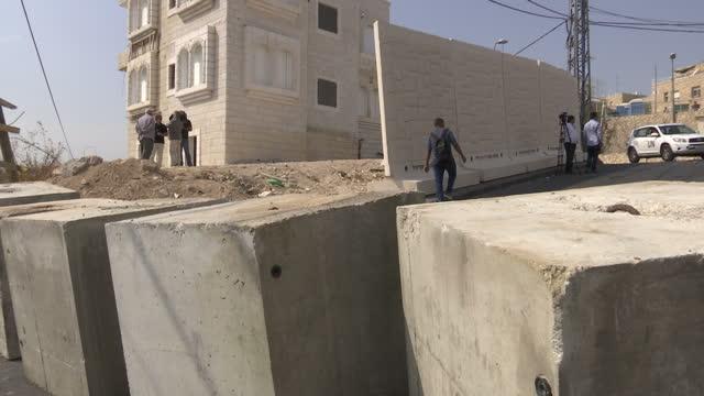 exterior shots of a temporary concrete dividing barrier in the jabel mukaber area of east jerusalem after a spate of recent violent attacks on... - east jerusalem stock videos & royalty-free footage