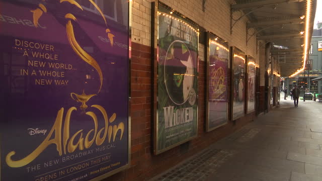 exterior shots of a tourist map of london's west end, advertising posters for various theatre productions including jersey boys, and street scenes on... - ウェストエンド点の映像素材/bロール