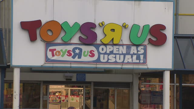 exterior shots of a toys r us store at a retail park, including shots of shoppers going in and out, an open as usual banner above the entrance and... - toys r us stock videos & royalty-free footage
