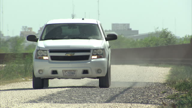 exterior shots of a us border patrol vehicle passing along the fenced border between the texan side of the rio grande and mexico on august 27 2014 in... - border patrol stock videos & royalty-free footage