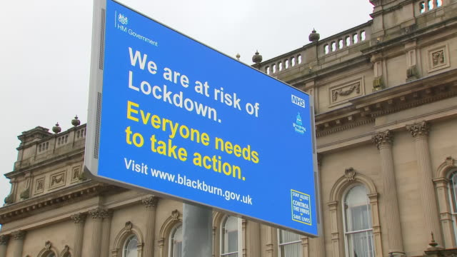 stockvideo's en b-roll-footage met exterior shots of a very quiet blackburn town centre with a digitial advertising board warning not to shake hands or hug on 24 july 2020 in blackburn... - {{asset.href}}