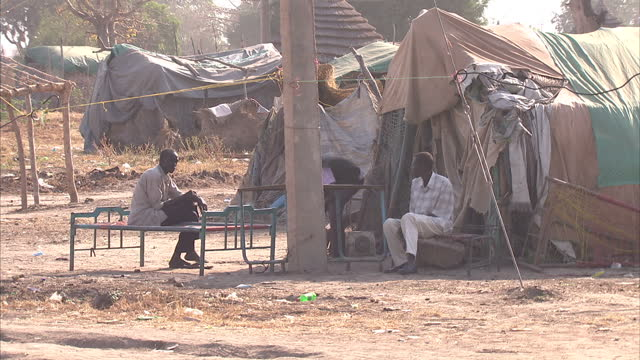 exterior shots of a village in southern sudan villagers in southern sudan on december 10 2010 in juba sudan - independence stock videos & royalty-free footage