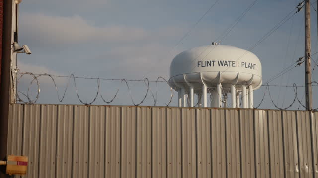 exterior shots of a water tower in flint after it was revealed the town's water supply is heavily polluted on january 22, 2016 in flint, michigan. - michigan stock videos & royalty-free footage