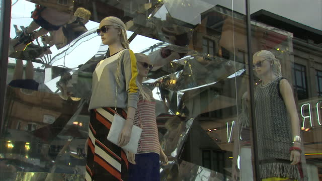 exterior shots of a window display with rotating fashion mannequins at the entrance to the flagship topshop store on oxford street>> on july 28 2015... - window display stock videos and b-roll footage