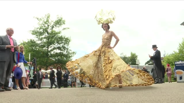 exterior shots of a women wearing an extravagant gold floral dress t at royal ascot racecourse 20th june 2018 ascot, england. - イギリス アスコット競馬場点の映像素材/bロール