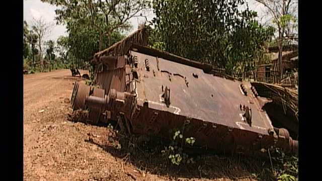 Exterior shots of a wrecked tank at the side of a country road on April 27th 1998 in Phnom Penh Cambodia
