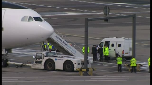 stockvideo's en b-roll-footage met exterior shots of abdelbaset ali al megrahi the convicted lockerbie bomber being led from a police van onto a libyan charter plane on 20 august 2009... - dumfries en galloway