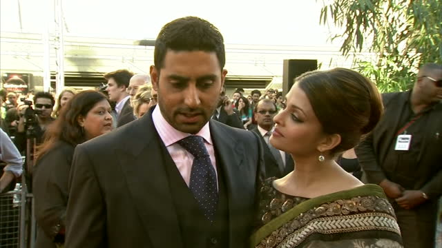 exterior shots of abhishek bachchan aishwarya rai bachchan arrive for the premiere of raavan give an interview on the red carpet at bfi southbank on... - bollywood stock videos and b-roll footage