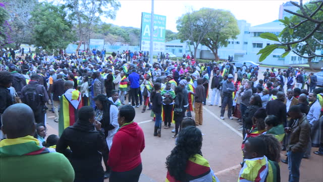 exterior shots of activists gathered outside of court in protest of the imprisonment of pastor evan mawarire on july 13 2016 in harare zimbabwe - pastor stock videos & royalty-free footage