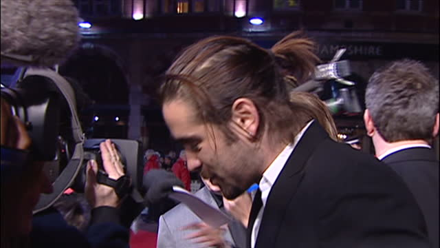 stockvideo's en b-roll-footage met exterior shots of actor colin farrell speaking to reporters on the red carpet and lighting a cigarette at the film premiere of alexander on january 5... - 2005