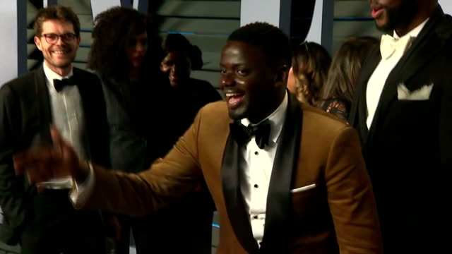 exterior shots of actor daniel kaluuya ignoring calls from reporters on the red carpet at the vanity fair oscars afterparty and greeting other guests... - daniel kaluuya stock videos and b-roll footage