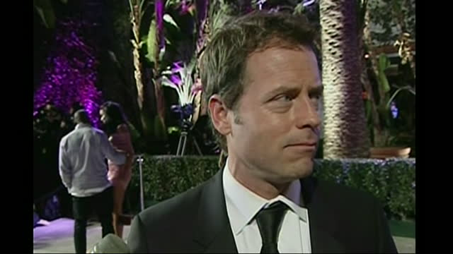 exterior shots of actor greg kinnear speaking to the press when arriving for vanity fair party after the oscars on 25 february 2007 in hollywood,... - oscar party stock videos & royalty-free footage