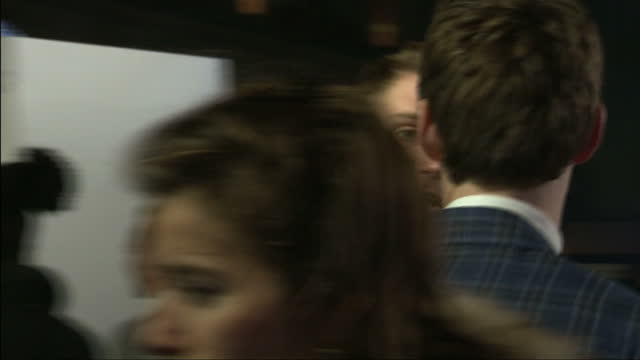 exterior shots of actor harry lloyd speaking to eddie redmayne at the premiere of 'the theory of everything'>> on december 09 2014 in london england - premiere stock videos & royalty-free footage