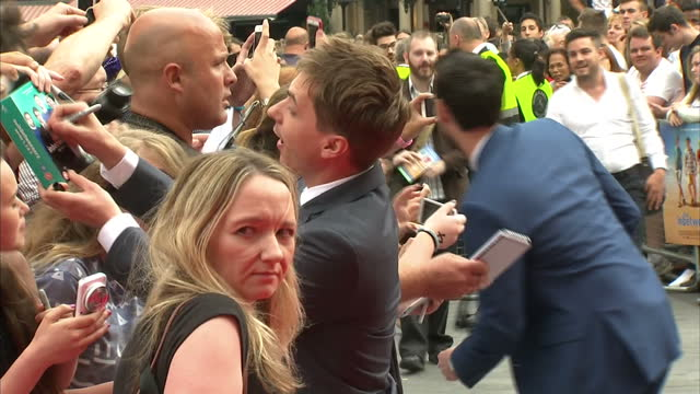 Exterior shots of actor Joe Thomas signing autographs and posing for 'selfies' with fans on the red carpet at the premiere of 'The Inbetweeners 2'...