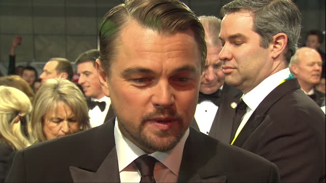 exterior shots of actor leonardo dicaprio giving an interview on the red carpet on february 16 2014 in london england - leonardo dicaprio stock videos & royalty-free footage