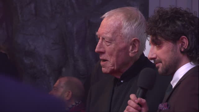 Exterior shots of actor Max Von Sydow being interviewed by Alex Zane at the premiere of Star Wars The Force Awakens at Leicester Square on December...