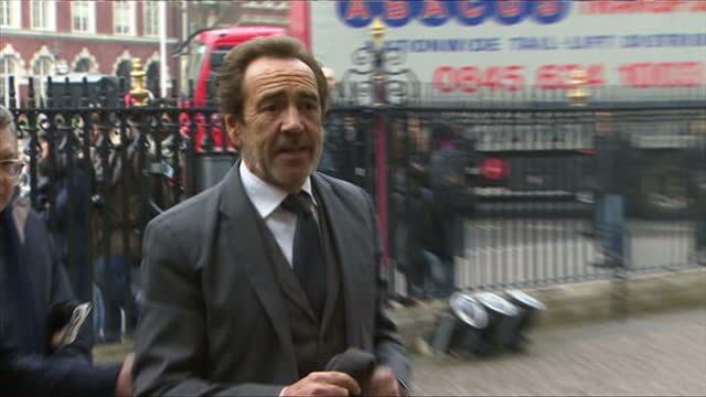 stockvideo's en b-roll-footage met exterior shots of actor robert lindsay and other guests arriving at westminster abbey to attend a service of thanksgiving celebrating the life adn... - adn