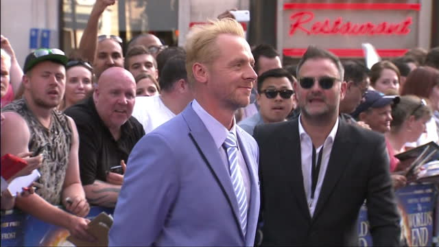 exterior shots of actor simon pegg on the red carpet at 'the world's end' premiere in leicester square. simon pegg on the red carpet at leicester... - the world's end stock videos & royalty-free footage