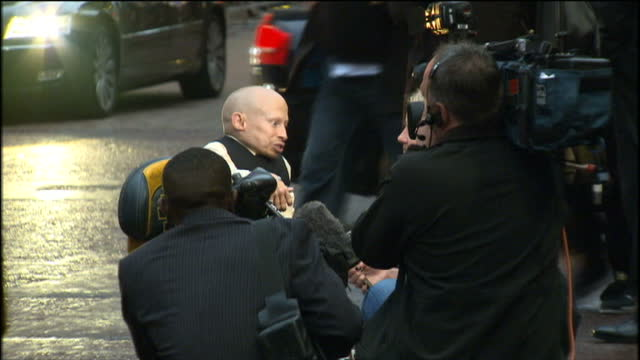 exterior shots of actor verne troyer talking to reporters at premiere of the imaginarium of doctor parnassus - verne troyer stock videos & royalty-free footage