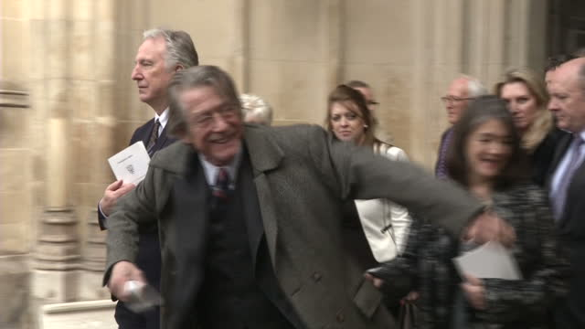 exterior shots of actors alan rickman and john hurt departing from westminster abbey after attending a service of thanksgiving for the life and work... - アラン・リックマン点の映像素材/bロール