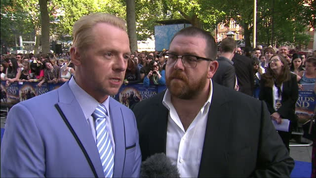 Exterior shots of actors Simon Pegg and Nick Frost being interviewed on the red carpet about 'The World's End' film at its premiere in Leicester...