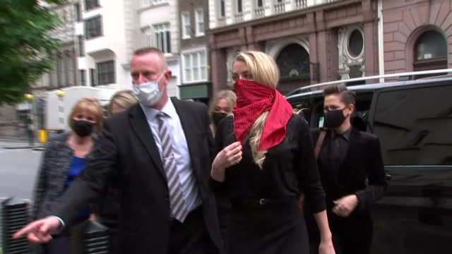 exterior shots of actress amber heard arriving at the high court for the second day of johnny depp's libel trial wearing a red scarf over her face... - amber heard stock videos & royalty-free footage