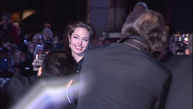 exterior shots of actress angelina jolie on the red carpet posing for paparazzi at the film premiere of alexander on january 5 2005 in london england - 2005 stock videos and b-roll footage