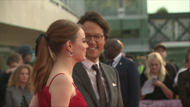 Exterior shots of Actress Emma Stone's red carpet arrival for the Maniac premiere and shots of Emma Stone posing for photos with Director Cary Joji...