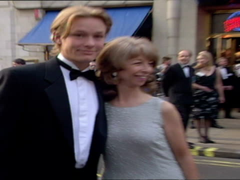 exterior shots of adam rickitt pose for photos on red carpet of bafta awards with helen worth - coronation street co-star adam rickitt on red carpet... - soap opera stock videos & royalty-free footage