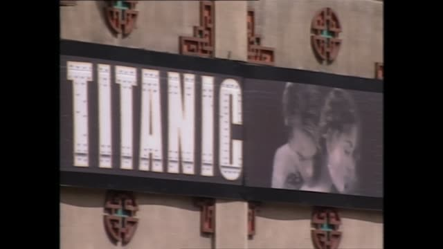 stockvideo's en b-roll-footage met exterior shots of advert for james cameron's titanic on 24th november 1998 in los angeles unites states - titanic