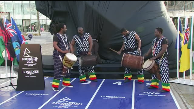 exterior shots of african drummer's playing whilst 2022 commonwealth games countdown clock is being unveiled on 9th march 2020 in birmingham england - commonwealth games stock videos & royalty-free footage