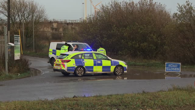 exterior shots of aftermath of a chemical tank explosion in avonmouth sewage plant, police road closure and shots of a silo was badly damaged in the... - storage tank stock videos & royalty-free footage