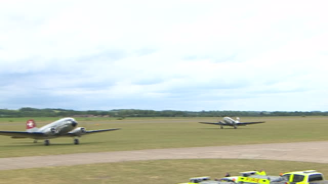 exterior shots of aircrafts carrying parachutists take off from imperial war museum duxford to commemorate the 75th anniversary of the dday landings... - d day stock videos and b-roll footage