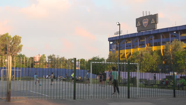 vidéos et rushes de exterior shots of alberto j. armando stadium also known as la bombonera and people playing football in a community pitch next to the stadium and... - la boca