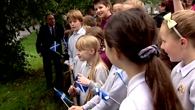 exterior shots of alex salmond meeting school children waving scottish flags after voting in referendum on september 18 2014 in strichen scotland - human age stock videos & royalty-free footage