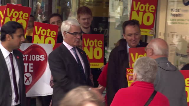 exterior shots of alistair darling and scottish deputy labour leader anas sarwar during walkabout greeting locals surrounded by vote no placards for... - alistair darling stock videos & royalty-free footage