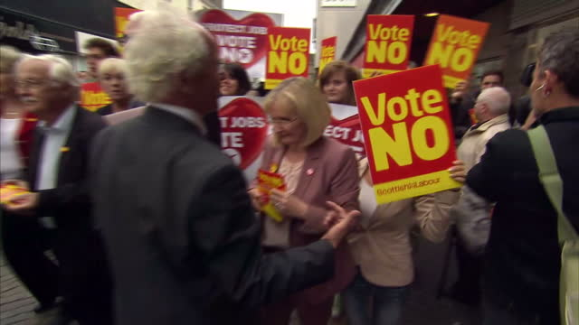 exterior shots of alistair darling during walkabout surrounded by vote no placards for scottish independence as an elderly local confronts him... - alistair darling stock videos & royalty-free footage