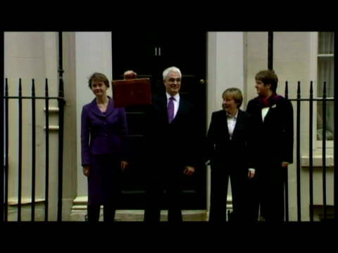 exterior shots of alistair darling standing outside 11 downing street holding aloft budget box - alistair darling stock videos & royalty-free footage