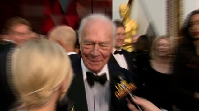 Exterior shots of Allison Janney greeting Christopher Plummer on the red carpet and Christoper Plummer speaking to reporters>> on March 04 2018 in...