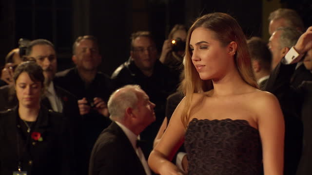 exterior shots of amber le bon attending the royal world premiere of 'spectre' at royal albert hall on october 26 2015 in london england - spectre 2015 film stock videos and b-roll footage