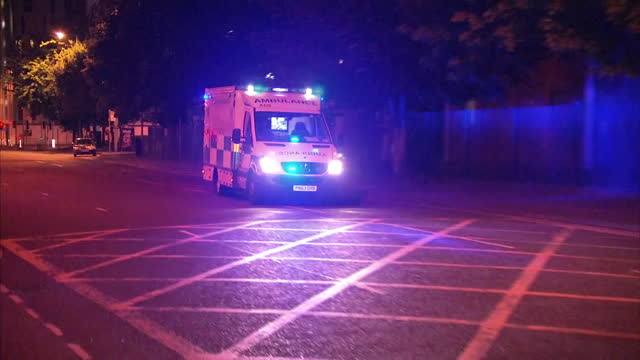 exterior shots of ambulances arriving at a hospital carrying wounded from the manchester arena after suicide bomber targeted an ariana grande concert... - manchester england stock videos & royalty-free footage
