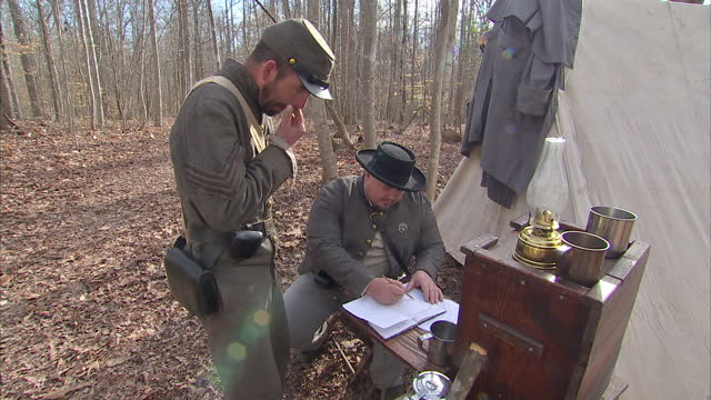 exterior shots of american civil war enthusiasts in period costume stood around in a forest camp chatting and drinking coffee on february 27 2016 in... - civil war stock videos & royalty-free footage