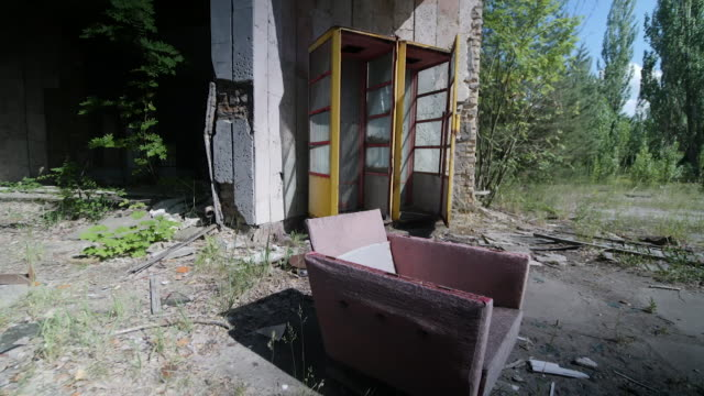 exterior shots of an abandoned derelict soviet supermarket with an old armchair outside on 18 june 2019 in pripyat ukraine - armchair stock videos & royalty-free footage